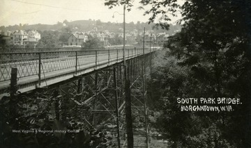 Postcard photograph of the South Park Bridge, also known as the Pleasant Street Bridge. Deckers Creek flows under the bridge. See the original for the correspondence written on the back.