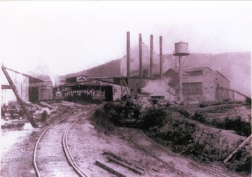 "View of the company's lumber mill and rail transportation. Information on the back of the photograph includes: ""Stephen D. Trail Su. Co. W. V. 2000 Roy Long Coll""."