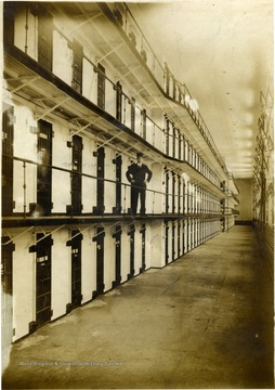 Unidentified guard stands on the second level of cells inside the state prison.