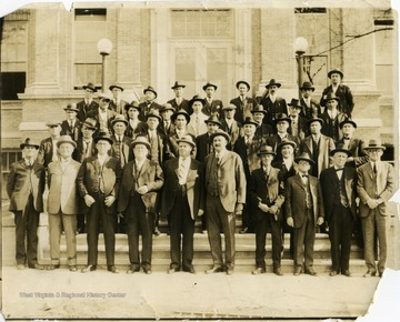 Photograph taken at Hinton High School. Identified L to R, Back Row: G. H. Harwood, Joe Hayth, Cecil Lively, N. S. Seldomridge, , --Patton, E. M. Bobbit, Isaac Meadows, --Eubanks, Brown Nunley;  Second Row: F. S. Hunter, --Poteet, Tom Youell, Wood Wickline, Clarence Seldomridge, Tom Rogers, Bert Ashley, George Nutting, Ira Wiseman; Third Row: Dick Cobb, E. K. Rogers, Lindsay Burks, M. M. Mastin, Bob Jones, Howard Honaker, Elmer Garten, Deifenbach, W. G. Dameron, C. H. Fredeking; Fourth Row: Bob Noel, Charlie Poore, Henry Ailstock, Lynn Gardner, Richard Thomasson, --Eubanks, --Cottle, --Hout, Tuney Swatts, C. I. Smith, C. S. Faulconer.