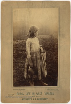 "Unidentified girl with a bucket on her arm, looks toward the open fields. The print at the bottom of the photograph includes, ""Made with Anthony's 2 B Equipment."" and ""Printed with N. P. A. Extra brilliant Albumen Paper""."