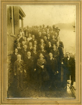 Portrait of the Hinton YMCA, taken outside on porch steps. The man with the beard is John R. Mott and the man in the 2nd row, 1st from right is G. K. Roper. All others are not identified. The photograph was given to Stephen Trail by Melvin Plumley.