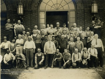 Group portrait of the Division Street Group City Water Works, probably in Hinton, West Virginia. No one in the photograph identified. This photograph was purchased by Stephen Trail in Hinton, West Virginia.