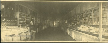 Photograph of the Hinton Drug Store on 3rd Avenue. Pictured are Wade H. Gwinn, Ed Rose and Mr. Sawyers. The photograph was given to Stephen Trail by Jim Pettrey from the Hinton Daily News Collection.