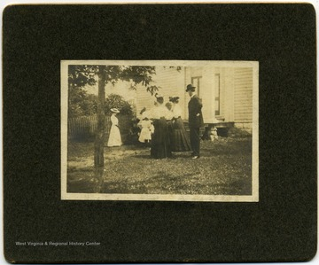 Photograph of a group of unidentified persons at Centerville Church. It was a Presbyterian church located in Monroe County.