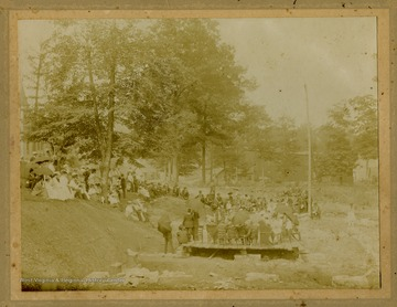 Photograph of the corner stone laying of a Presbyterian church. All persons in the photograph are unidentified. The church was located in Wise County, Virginia.