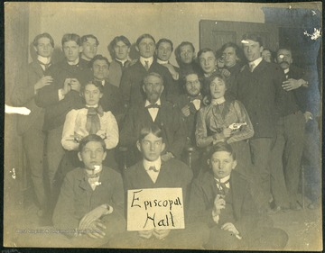 Several wide-eyed subjects in this photograph are holding pistols.