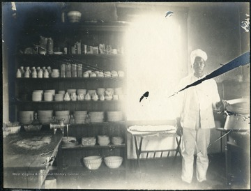 Unidentified African-American man standing in food preparation area.