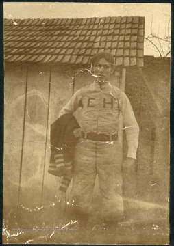 "Unidentified student wearing a uniform with ""EH"" for Episcopal Hall."