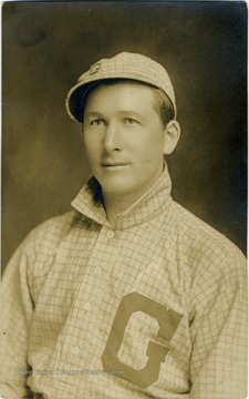 "Young man wearing a baseball uniform with a large letter ""G"" on the shirt."