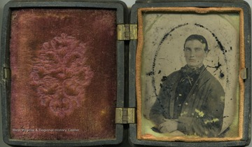 Cased ambrotype photograph of an unidentified young man. The emulsion of this fragile image is beginning to fall off the plate. Ambrotypes were popular in the mid-1800's