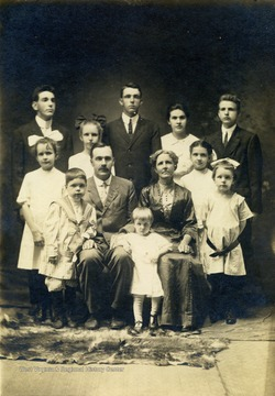 Pictured with their ten children: Harry, Lance, Kate, James, Jane, Mary, Anna, Sophie, Howard, and Eva.