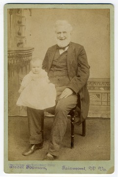 "Portrait of a smiling, elderly Governor Francis H. Pierpont holding an unidentified infant. Pierpont served as the Governor of the Restored Government of Virginia which was loyal to the Union during the Civil War. He is known as ""The Father of West Virginia"""