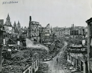 "Information with the photograph, ""A lone soldier of the 100th Infantry Division, Seventh U.S. Army, walks through the ruins of Heilbronn, Germany, cleared of the enemy April 12, 1945. Forty miles southeast of Mannheim and the Rhino, Heilbronn, an important road and rail center was blasted by Allied Planes. U.S. Signal Corps Photo."""