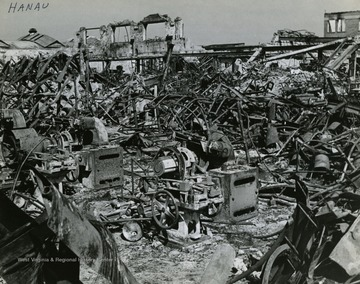 "Information included with the photograph,""Overall view showing the damage done by the RAF and the U.S. Eighth Air Force to the Deutsche Dunlop A.G. Tire and rubber factory at Hanau. The widespread destruction in this plant severely cut part of the German tire production for motor vehicles. This part of the plant ceased to produce after the last air attack that left it the mass of twisted girders and rubble shown."" See the back of the original photograph for more information."