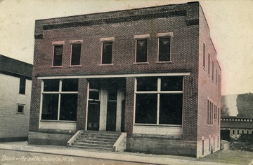Hand painted image of bank entrance. (From postcard collection legacy system.)