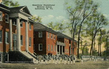 A group of uniform-clad military students in formation. Published by Mason Bell. See original for correspondence. (From postcard collection legacy system.)