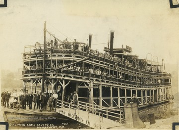 "Passengers crowd along the deck of ""Princess"" before heading off on the Monongahela River."