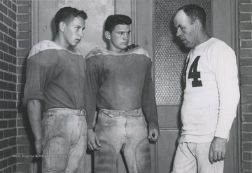 McLaughlin, pictured on the right, speaks with two of his Alderson High School players. He coached and taught at the school from 1936 to 1962.