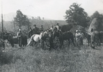 Workers and their horses pictured on the farm on Barksdale Mountain.