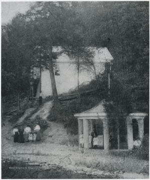 People pictured in front of the home and inside the gazebo on the grounds. No subjects identified.