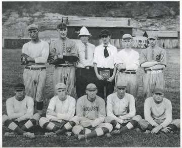 Front row, L to R: Toots Rogers, Benny Hess, Charlie Lane, Willey Aihstock, and unidentified. Back row, L to R: Buff Collins, Footy Stover, John Fisher, Windy Waid, Josh Fox, and unidentified.