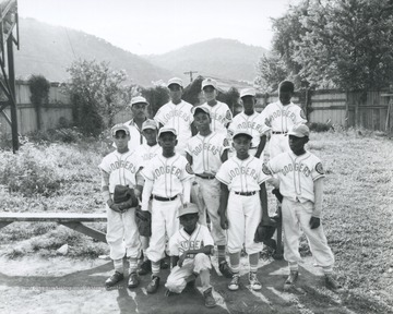 "African-American members of the ""Dodgers"" pose for their team photo."
