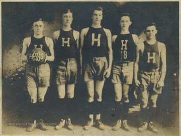 Team portrait of the high school's basketball team. Subjects unidentified.