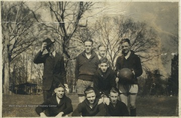 Unidentified persons gather to play a game of basketball.