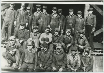 "Photo of Machinists, electricians, carman, etc. Front row, left to right: Jack Wicker; ""Dec"" Meadows; Jim Lindsay; Lynn W. McMann; Ted Haythe; Charley Young. Middle row, left to right: Hershel Gilpin; Raymond Thornton; Bill Lovelace; Bob Terry; Norvel ""Dink"" Reid; Charlie Norris. Back row, left to right: Ferrell Harford; Ike Bowman; Merritt Reid; Moody Burdette; EK ""Toots"" Rogers; Merridith Nicely; Chris Baer; WA ""Fatty"" Arrington; ""Blu Jay"" Nicely; JD ""Dizzy Turner."