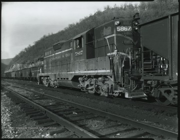 A train occupies the tracks of the yard near Hinton, W. Va.