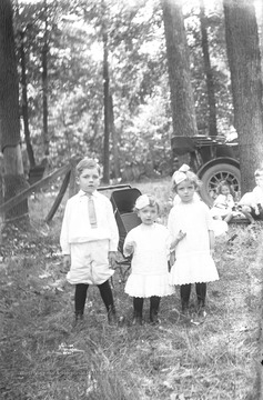 Photograph of several young children, dressed in their best white, bibs and tuckers, most likely location is near or in Preston County, W. Va.
