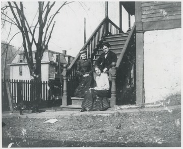 Murrell is pictured on the lower step of her porch located on the corner of 5th Avenue and Summers Street. Her associates are unidentified.