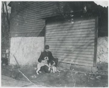Murrell pictured with two dogs outside his house located on the corner of 5th Avenue and Summers Street.