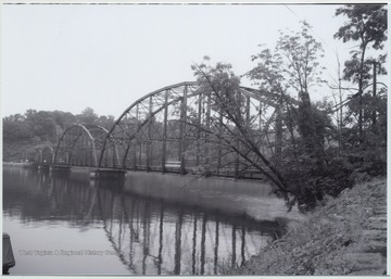 Photo showing the bridge over Cheat Lake. The bridge was built in 1922 by the Independent Bridge Company of Pittsburgh. It spans across the lake along County Route 857.