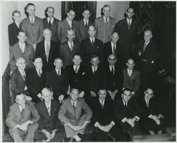 Pictured from left to right in the back row is Henry Harrison, Mr. Ketchum, unidentified, Jack Mann, B. Thompson, Mr. Minichian, and Bill Miller.In the third row, from left to right, is Mr. Vass, unidentified, Mr. Garten, Earnest Allen, S. O. Gum, and Jon Taylor.In the second row, from left to right, is Emmitt Mann, Lee Barnett, E. C. Eagle, unidentified, Harry Humphries, Walter Jackson, and Bernard Gerch.In the first row, from left to right, is Bert Hout, Guy Belcher, Fred Maddy, unidentified, Lynn Miller, and unidentified.