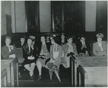 Pictured from left to right in the front is Nina Harrison, Edna Wyard, Maude Mann, Mrs. Bert Hout, Adie Gooch, Hazel Barnett, and Mrs. Allen Hill.In the back row, from left to right, is Mrs. Whanger, Elizabeth Miller, and Maud Jackson.