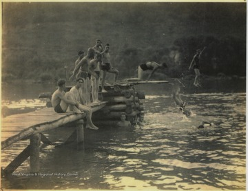 A group of unidentified men spend time by the swimming hole located on the banks of New River. Here, life saving techniques were taught to the members of the Civilians Conservation Corps (CCC).