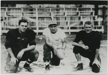 Jack Dillon, left, and Al Morgan,right, pose with their coach in front of the bleachers.