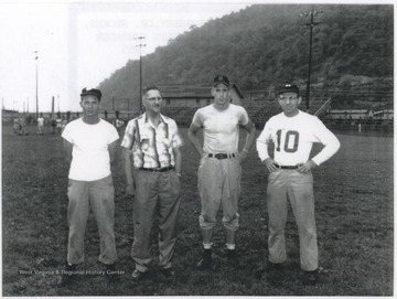 From left to right, Harold Beasley, Dr. Stokes, Bill Garten, and Charlie Schrader pictured on the field.
