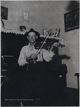 Hartford pictured playing his instrument at the 1717 Temple St. residence. Hartford made fiddles and clocks, and was known for his mastery in woodcraft.