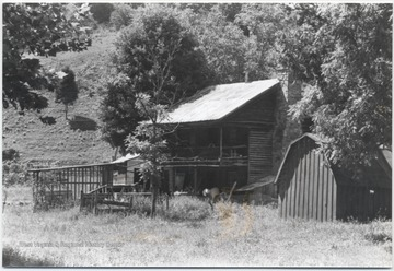 View of the home from across the field. The Hutchinson family was the earliest settler in the Forrest Hill District near the Greenbrier River.