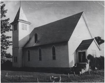 First built in 1910 and burned down in 1913. Since this picture, the church has covered the exterior with brick and decorated the interior with paneling with new pews and wall-to-wall carpet. Sunday School rooms have also been added, including a fellowship room, a kitchen, and more ground for parking cars.