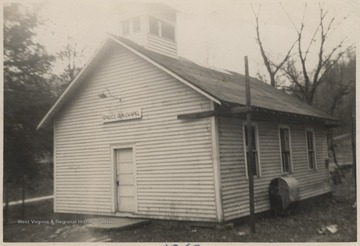 Looking at the entrance of the church building located in Forest Hill District outside of Hinton, W. Va.