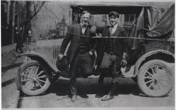 Two unidentified men pose by the intersection of Ballengee Street and 3rd Avenue.