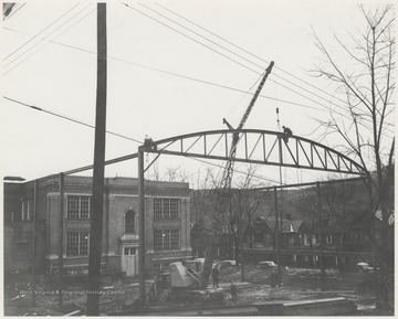 Construction workers at the site of the Hinton High School gymnasium. Subjects unidentified.