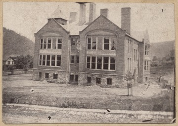 Photograph looking at the old Hinton High School building from across the street.
