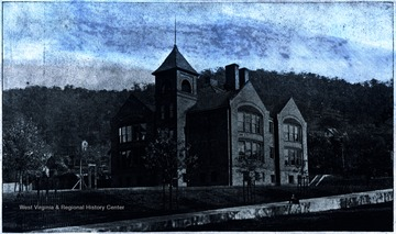 Negative of the first high school building constructed.