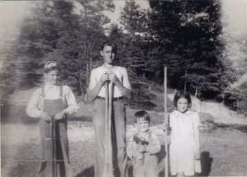 Jim, Bill, Bob and Juanita Sirk, the children of Bernie and Pauline Sirk of Preston County, West Virginia.