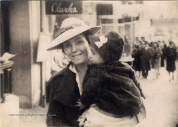 Pauline Barr Sirk holding her youngest daughter, Mary, on a street in Terra Alta, West Virginia.